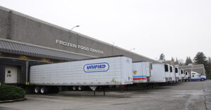 a several trucks outside of a frozen food facility