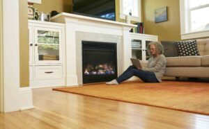 woman in front of fireplace
