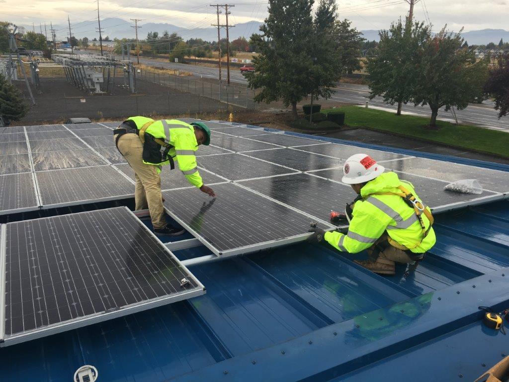 Workings installing solar