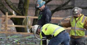 Workers installing metal