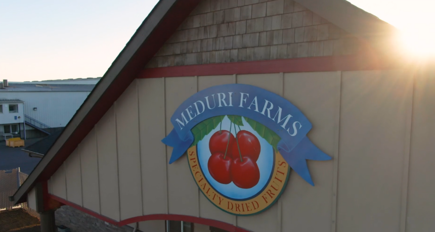 a sign on the side of a building, reading meduri farms