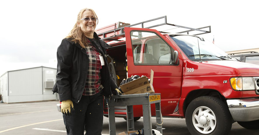 Woman contractor in front of truck