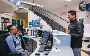 person chatting with receptionist