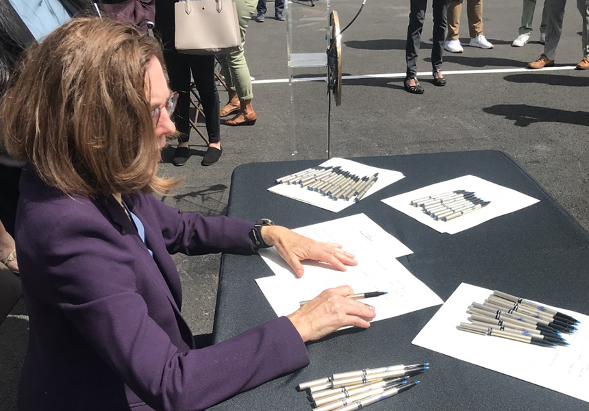 Governor Kate Brown signing documents