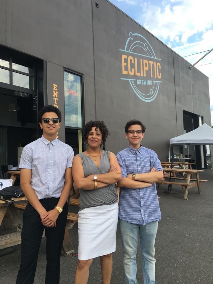 woman with sons in front of brewery