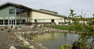 Exterior of hospital with pond